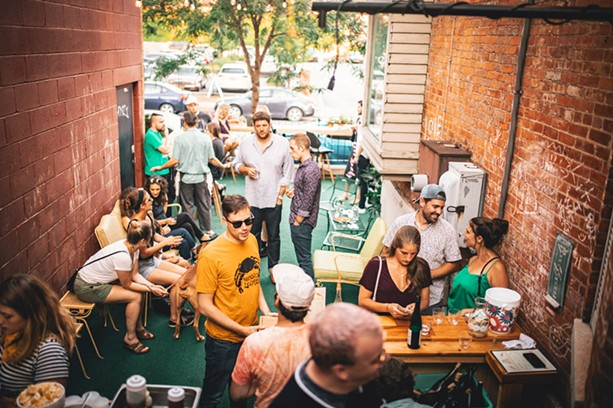 The first Aldaskeller Wine Co. pop-up in July, on the side patio at Swan Dive, was well-attended. - PHOTO BY JASON CAMPBELL