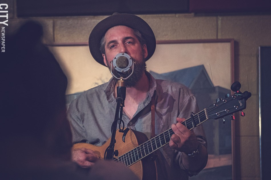 Ben Haravitch, a.k.a. Benny Bleu, performing during his August residency at The Little Theatre Cafe. - PHOTO BY RYAN WILLIAMSON