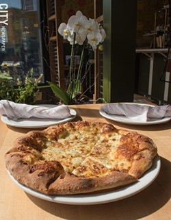 The white pizza is tasty simplicity. - PHOTO BY JACOB WALSH