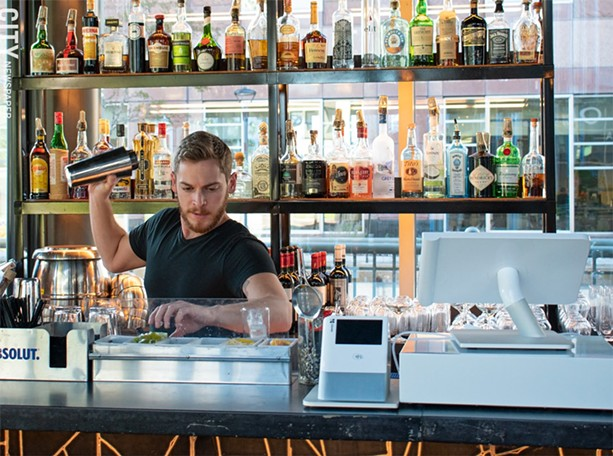Adam tends the bar at VOLO. - PHOTO BY JACOB WALSH
