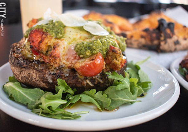 The Baked Portobello includes lobster meat, cherry tomato, mozzarella, and pesto. - PHOTO BY JACOB WALSH