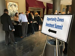 The city held an Opportunity Zones Investment Summit so people could learn about a federal tax incentive tied to investing in designated city neighborhoods. - PHOTO BY DAVID ANDREATTA