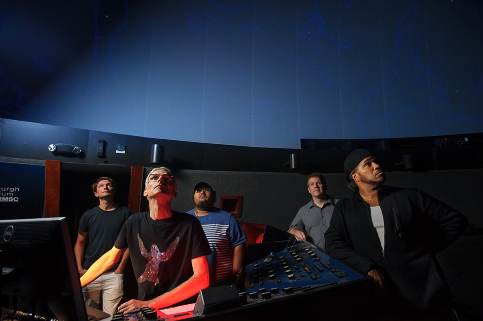 (Left to right) Drummer Tommy Mintel, Steve Fentress, bassist Luis Carrion, keyboardist Ian Sherman and guitarist Brother Wilson at the Strasenburgh Planetarium. - PHOTO BY DORIAN MODE