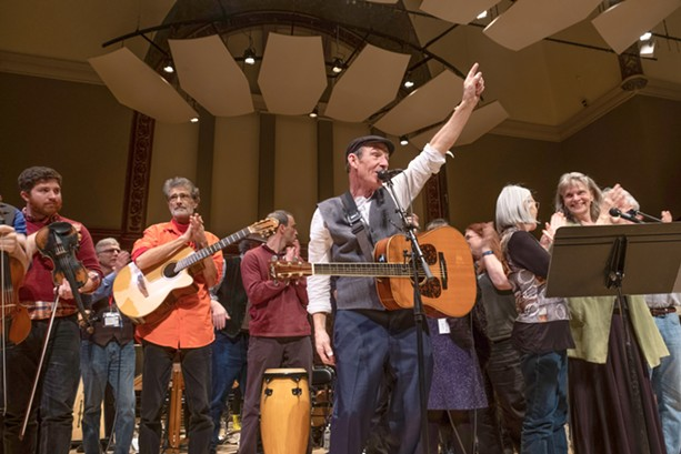 John Dady (foreground) leads the musicians at Hochstein Performance Hall in a concert tribute to his brother, the late Joe Dady. - PHOTO BY JULIE GELFAND