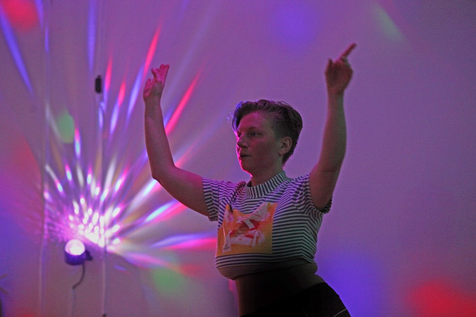 """Angela Hakkila, 37, of Rochester, dances in a Zumba class at Positive Force Movement. Hakkila uses """"they"""" for a personal pronoun. """"That's sort of a new thing. … I'm so grateful to have a space where I can dance and feel supported in that at the same time. It's huge."""" - PHOTO BY MAX SCHULTE"""