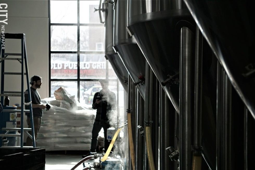 Steam rises from kettles at Three Heads Brewing on Thursday, January 30. The brewery was producing a new batch of The Kind IPA, Three Heads' best-selling beer. - PHOTO BY GINO FANELLI