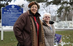 "Carolyne Blount, left, researched many of the stories featured in ""Beyond These Gates: Mountains of Hope in Rochester's African-American History,"" a book Marilyn Nolte, right, co-authored with African-American history scholar Verdis Robinson. - PHOTO BY MAX SCHULTE"