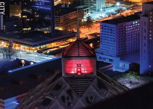 Legacy Tower was lit up in red to honor Susan B. Anthony's birthday. - PHOTO BY RYAN WILLIAMSON