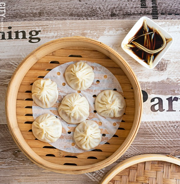 Xiao Long Bao are filled with hot broth, leeks, and a protein (usually chicken or pork). - PHOTO BY JACOB WALSH