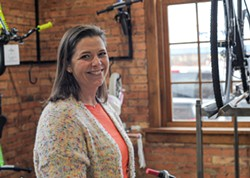 Shana Lydon, general manager at Full Moon Vista, said the shop learned this week that the state will allow it to stay open because it performs bicycle repairs. - PHOTO BY JEREMY MOULE