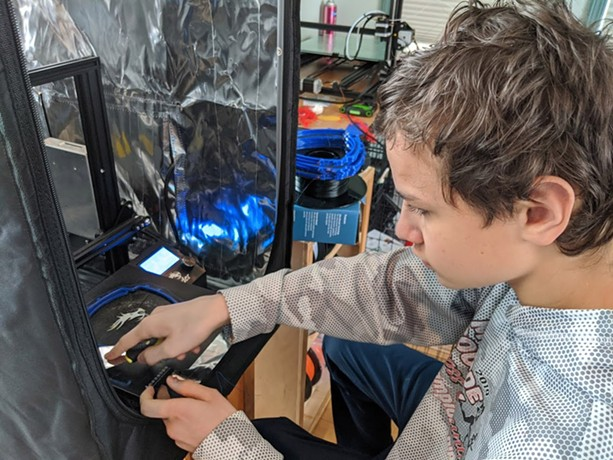 David Gerard works on a 3D printed headband for a face shield. - PHOTO PROVIDED