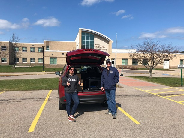 Bill Ottman, Webster Central School District's director of science and technology, met Coty Pastene in a parking lot to hand off a 3D printer owned by the district and a supply of filament for it. - PHOTO PROVIDED
