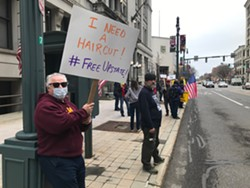 Tom Antinora, of Penfield, was among a few dozen demonstrators calling for businesses to reopen amid the coronavirus pandemic on Friday, May 1, 2020. - PHOTO BY DAVID ANDREATTA
