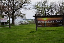 The welcome sign at Durand Eastman Beach. - PHOTO BY GINO FANELLI