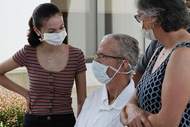 Ted O'Brien speaks with reporters outside Unity Hospital in Greece. O'Brien spent 68 days in hospitals for COVID-19 treatment. - PHOTO BY MAX SCHULTE