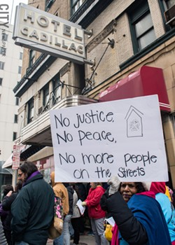 Advocates for quality, affordable housing protesting in April 2019 in front of the Hotel Cadillac in downtown Rochester. - FILE PHOTO