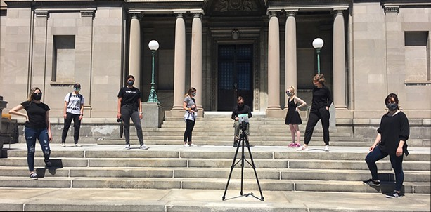 MAG Director Jonathan Binstock, center, sits on the gallery steps. The gallery says it is eyeing June 27 for re-opening, pending decisions by health and government officials. - PHOTO PROVIDED