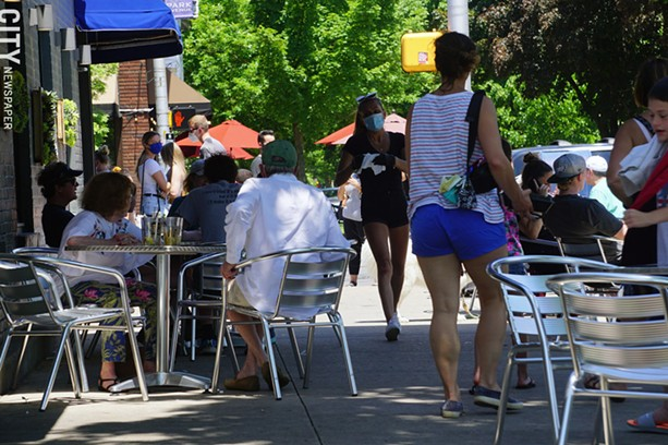 The scene outside Blu Wolf Bistro on June 4, 2020, the first day outdoor restaurant seating was re-introduced. - PHOTO BY GINO FANELLI