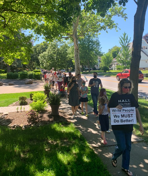Black Lives Matter organizers held a march in Fairport on Sunday, June 7, which was attended by about 200 people. - PHOTO BY ALEXA GUZMÁN