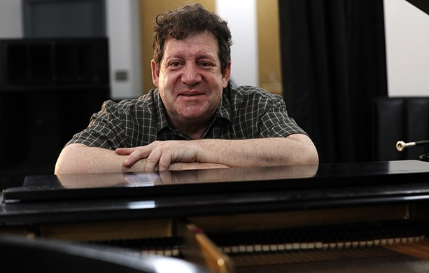 Jazz musician Jon Seiger lost his hearing when he was 32 and stopped playing music. He later had cochlear implants in both ears, taught his brain how to interpret the electronic signals and started performing again. - PHOTO BY MAX SCHULTE / WXXI NEWS
