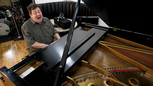 """Seiger plays trumpet and piano and sings like Louis Armstrong. """"I hope ... I can keep just a little bit of the joy he wanted to give the world,"""" he says. - PHOTO BY MAX SCHULTE / WXXI NEWS"""