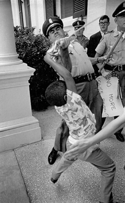 Herron, who helped chronicle the civil rights movement, captured this image in Jackson, Mississippi, in 1965. - PHOTO BY MATT HERRON