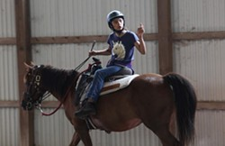 Toni Ayala, 12, of Rochester, has found a home away from home at the stables, saying she comes every day — even if it's just to feed the horses. - PHOTO CREDIT MAX SCHULTE / WXXI NEWS