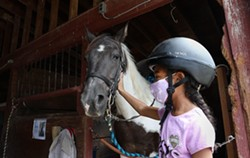 """Jayla Rogers, a 9-year-old who lives in Gates attended a one-week camp at A Horse's Friend this summer. """"She really enjoyed her time there and has a passion for animals, especially horses,"""" says Jayla's mother, Sara Rogers. - PHOTO CREDIT MAX SCHULTE / WXXI NEWS"""