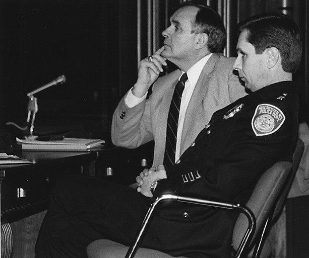 Former RPD Chief Delmar Leach (left) and Deputy Chief Terence Rickard at a City Council hearing on police brutality in December 1985.
