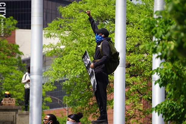 A man gives the Black Power salute of a raised fist at a protest in Rochester on May 30, 2020. - PHOTO BY GINO FANELLI