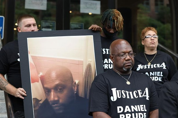 Daniel Prude's brother, Joe Prude, outside City Hall on Wednesday, Sept. 2, 2020, to announce plans to sue the city over Prude's death. - PHOTO BY MAX SCHULTE