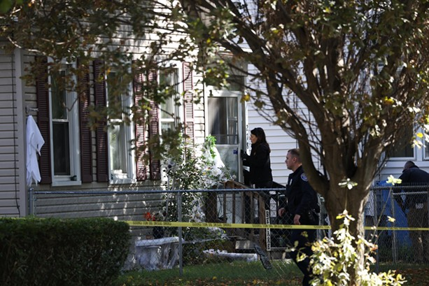 A Rochester Police Department Major Crimes investigator enters 278 Pennsylvania Ave., where a large party had been held Friday night into Saturday morning. Early Saturday, Jaquayla Young and Jarvis Alexander, both 19, were killed in a mass shooting that wounded 14 other people. - PHOTO BY MAX SCHULTE