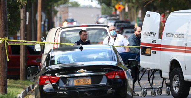 The Monroe County Medical Examiner took custody of two bodies from the backyard of 278 Pennsylvania Ave. after a mass shooting took place. - PHOTO BY MAX SCHULTE
