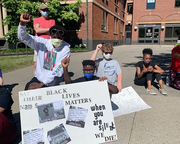 Students rally outside the Fairport Village Hall and Police Department in June 2020. - PHOTO BY ALEXA GUZMÁN