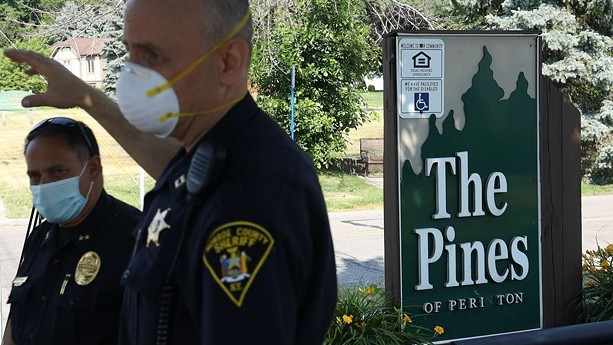 Fairport Police Chief Sam Farina (left), and Monroe County Sheriff's Deputy Capt. Andrew DeLyser address the media outside the Pines of Perinton in July 2020. - PHOTO BY MAX SCHULTE