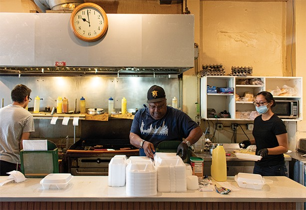 James Brown trains two new employees at his diner, James Brown's Place. He expects that the deal to sell the restaurant will close in early October 2020. - PHOTO BY JACOB WALSH