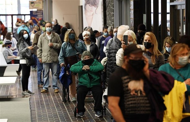 Voters waited in long lines at Perinton Square Mall over the weekend to cast their ballots early. Sunday, Oct. 25, 2020. - PHOTO BY MAX SCHULTE
