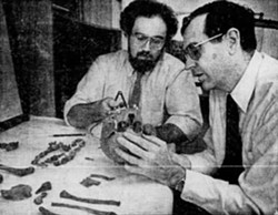 Brian Nagel and Charles Hayes check a skull that had been removed from a burial site in Highland Park in this 1984 Democrat and Chronicle file photo found on Newspapers.com. - NEWSPAPERS.COM