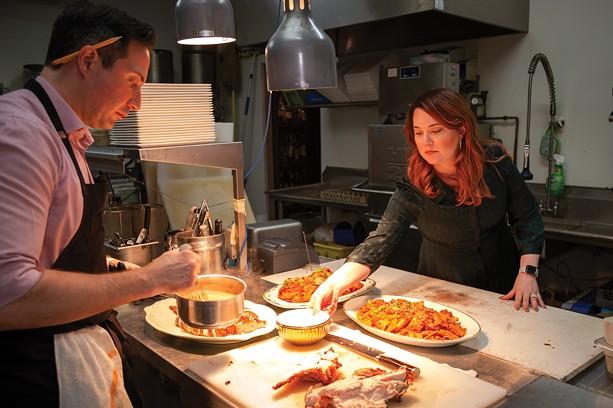 Tim and Janine Caschette prepare their annual Thanksgiving feast at their Brighton restaurant, Avvino. - PHOTO BY VINCE PRESS