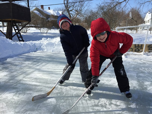 Lucas and Owen Andreatta on the Andreatta backyard rink in Fairport. - PHOTO BY DAVID ANDREATTA
