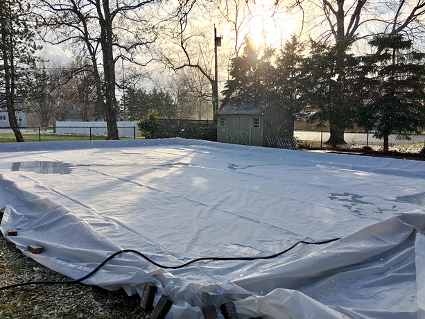 """Mos Iceley,"" the backyard rink of Joseph Climek and Melody King in Webster, filling up with water. - PHOTO COURTESY OF JOSEPH CLIMEK AND MELODY KING"