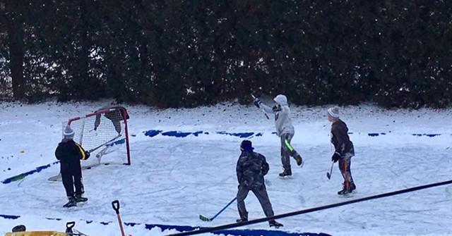 Children play hockey on the Vadney family backyard rink in Perinton. - PHOTO COURTESY OF SCOTT VADNEY