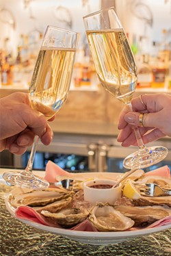 Champagne and oysters from the Erie Grill. - PHOTO BY JACOB WALSH