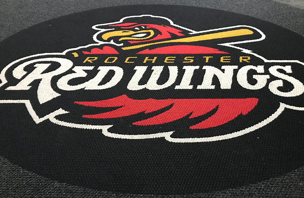 The Rochester Red Wings logo is emblazoned on the carpet of the team's clubhouse. - PHOTO BY DAVID ANDREATTA