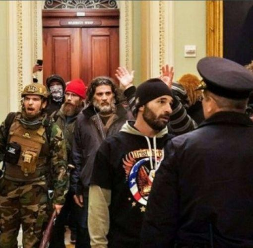 Insurrectionists stormed the Capitol on Jan. 6, 2021. Federal prosecutors say the bearded man in the center of the photo is Dominic Pezzola of Rochester. - PHOTO COURTESY U.S. ATTORNEY'S OFFICE