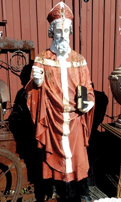 The statue of St. Boniface was painted red when it was discovered in an antique shop in Avon, Livingston County, prior to its return to St. Boniface Catholic Church in Rochester. - PHOTO PROVIDED BY JOSEPH PASQUARELLI