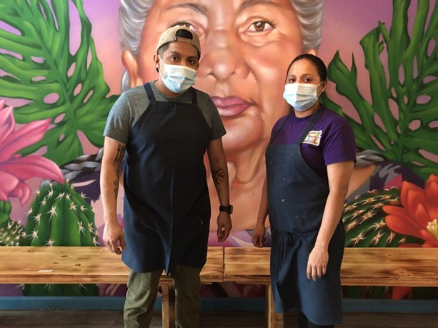 From left, siblings Fidelio Rita Jr. and Ojarya Rita are co-owners of Neno's Mexican restaurant. - PHOTO BY NOELLE E.C. EVANS / WXXI NEWS