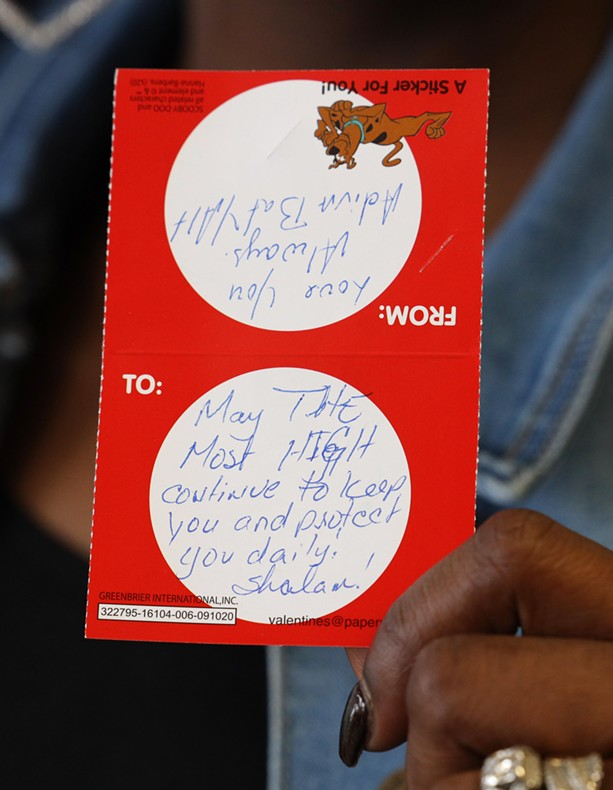 """Fullilove holds up a valentine addressed to the young girl. The note reads: """"May the Most High continue to keep you and protect you daily. Shalom!"""" - PHOTO BY MAX SCHULTE / WXXI NEWS"""