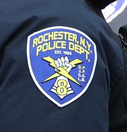 The RPD's Tactical Unit patch on the shoulder of an officer. - PHOTO BY MAX SCHULTE