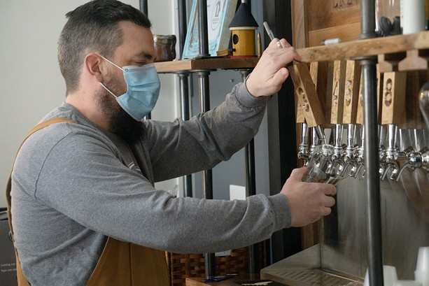 Greg Searles, co-owner of Birdhouse Brewing in Honeoye, pours a pint of ale. - PHOTO BY GINO FANELLI
